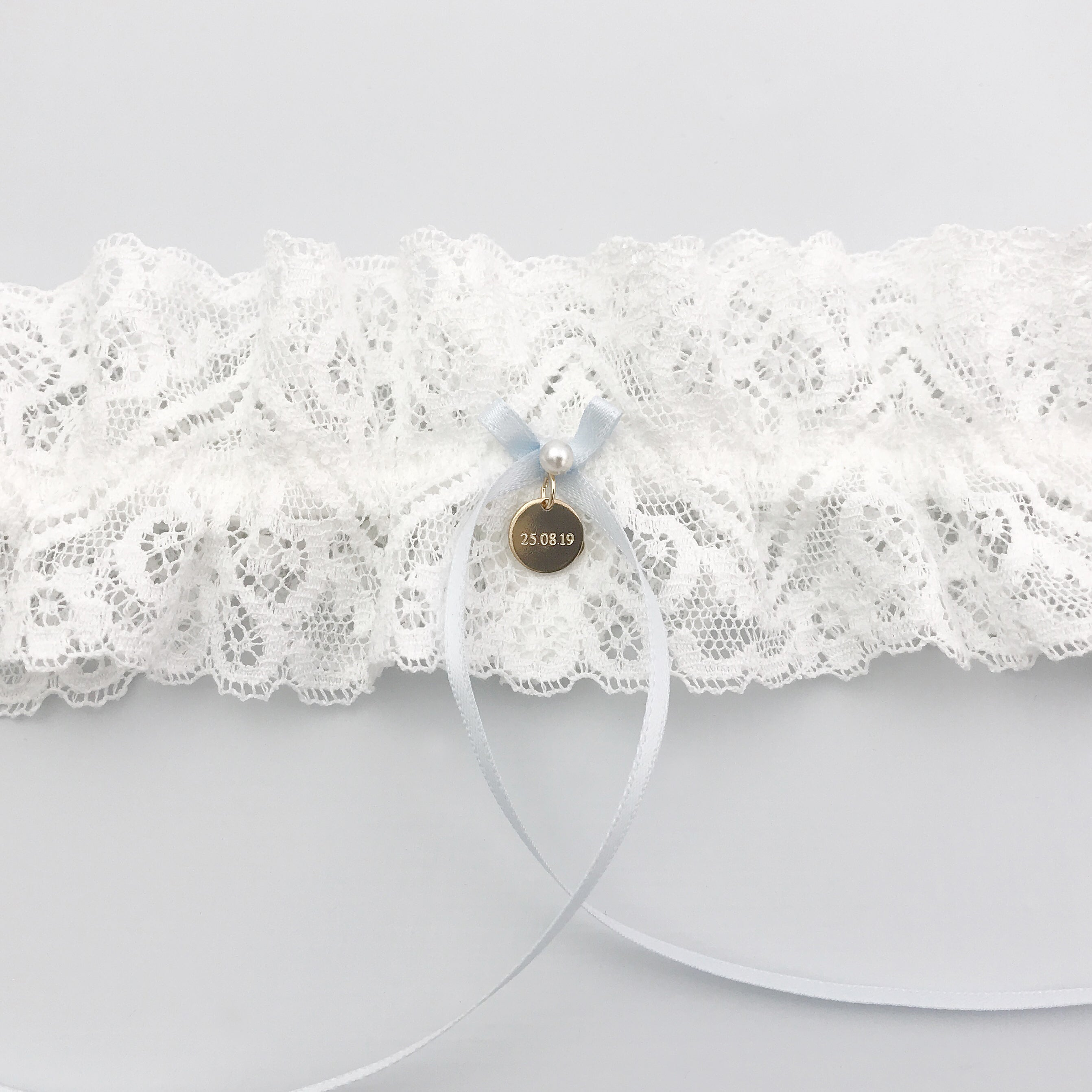 personalised garter with gold engraved charm