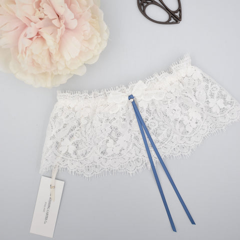 Lace wedding garter with something blue bow