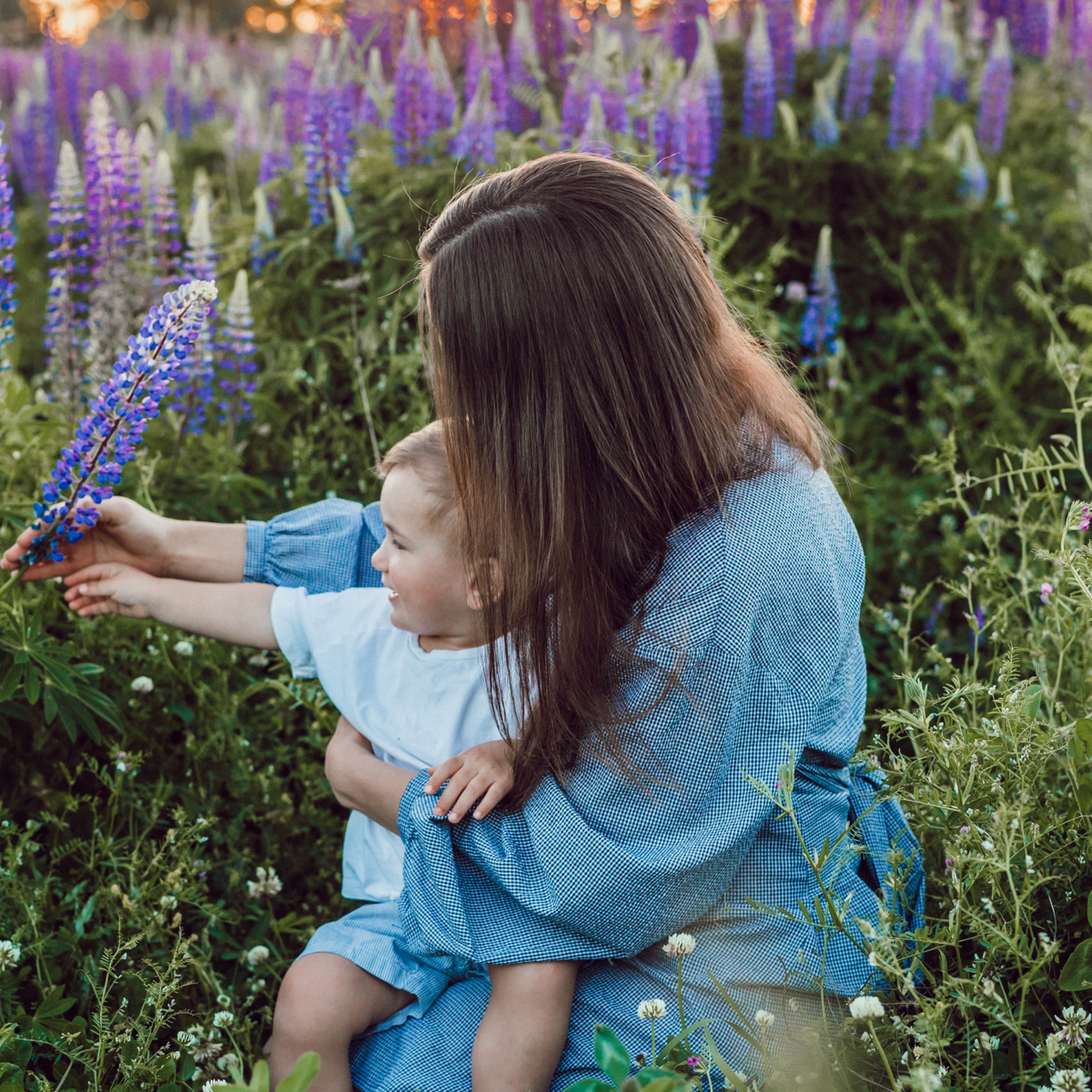 mom and baby picking lavender