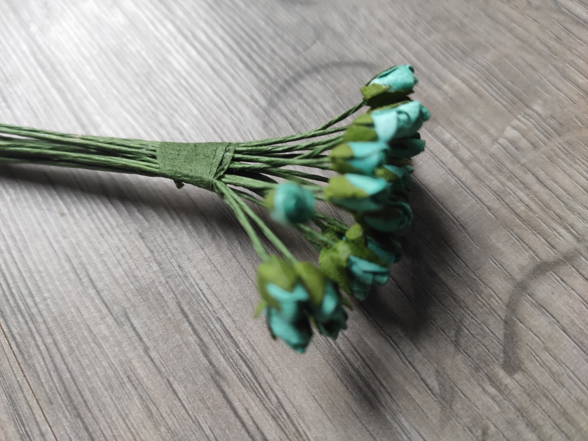Set of tiny turquoise flowers