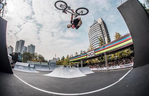 BMX RIDER CATCHING AIR AT A COMPETITION