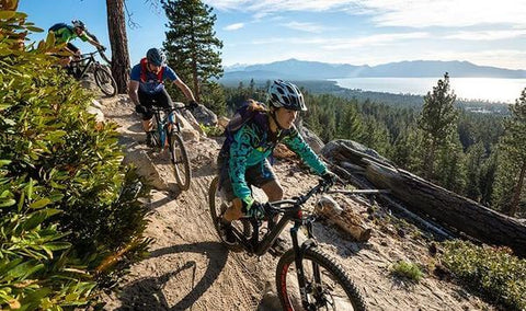 MOUNTAIN BIKERS RIDING ABOVE SOUTH LAKE TAHOE