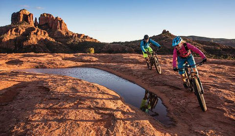 MOUNTAIN BIKERS RIDING IN SEDONA'S RED ROCKS