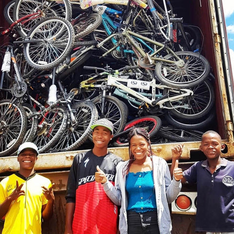 Africa Project charity bikes unloading