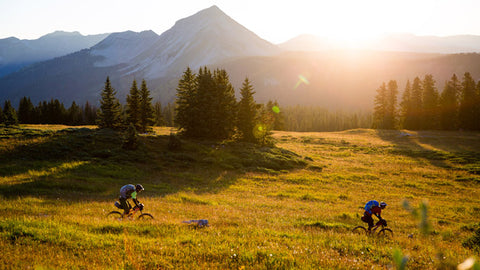 MOUNTAIN BIKERS IN A MOUNTAIN MEADOW