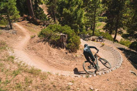MOUNTAIN BIKER RIDING PAVERS AT SNOW SUMMIT