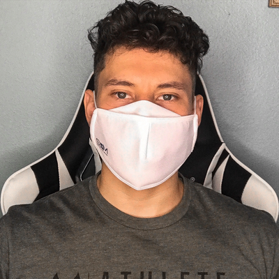 Young adult male wearing the white Smart Pro Mask with fog guard.
