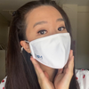 Young woman wearing the white Smart Pro Mask without using the fog guard.