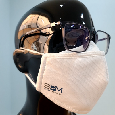 Mannequin head wearing glasses with white Smart Pro Mask demonstrating the fog guard.
