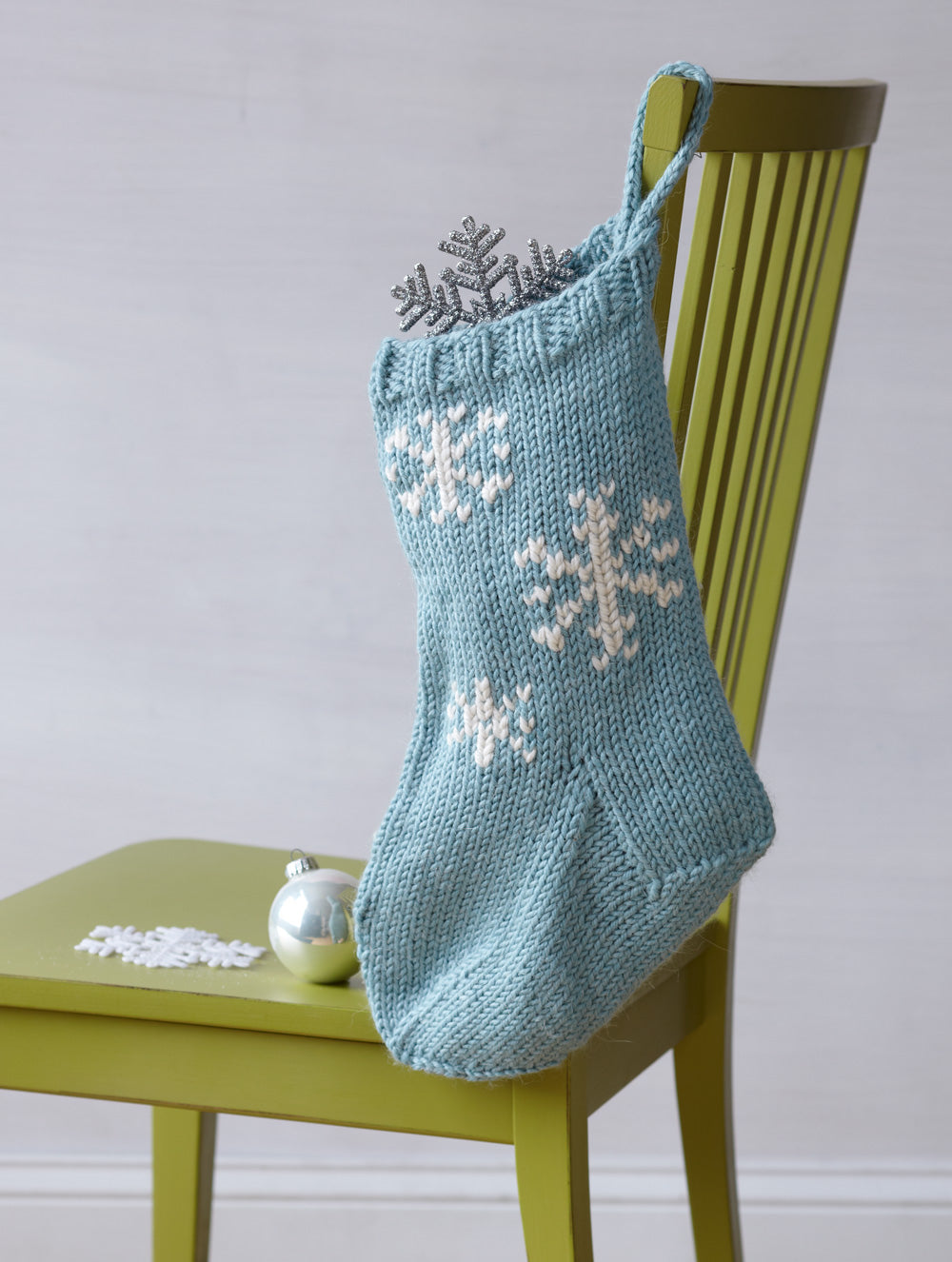 Elegant blue and white Christmas stocking knitting pattern using duplicate stitch