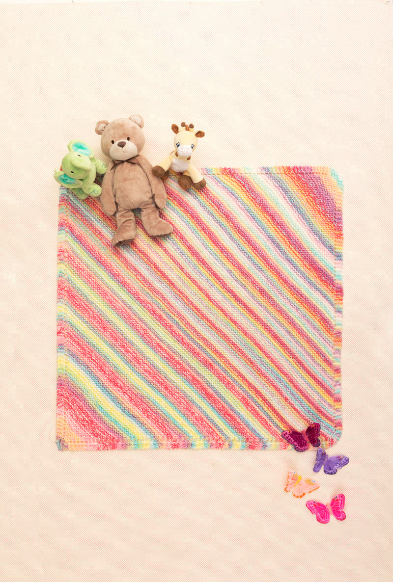 Super easy diagonal garter stitch baby blanket in pastel colors from Lion Brand