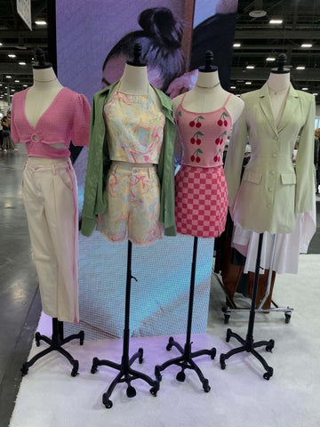 70s wavy colorful pastel rainbow prints, neon pinks, cropped skirts, cropped tops, blazer jackets