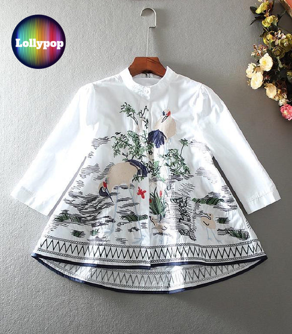 women-white-silk-embroidered-kurti