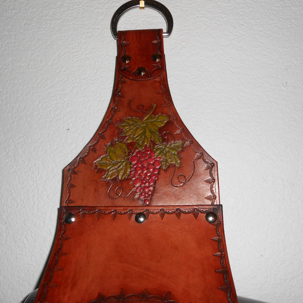 Detail on four bottle leather wine holder by Montana Leatherworks