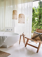 Photo of rattan lights hanging above a free standing bath