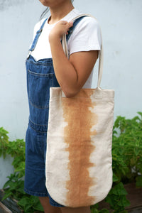 A Stylist Rounded Canvas Tote with character- Xiapism Natural Dye
