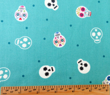 Load image into Gallery viewer, Lewis & Irene - Small Things Glow - Sugar Skulls on Turquoise - 1/2 YARD CUT