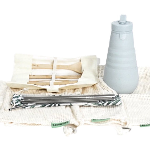 includes reusable grocery bags, metal straw set with boba, stojo collapsible water bottle, bamboo utensil kit