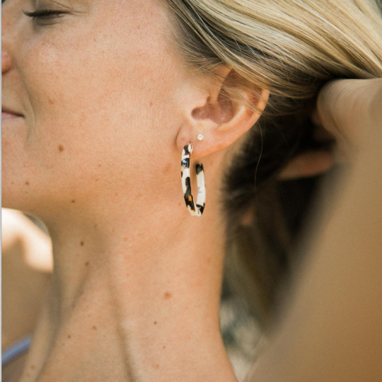 These classic hoop earrings with a spin are made of cellulose acetate, which is a renewable resource made from wood pulp. You can say goodbye to petroleum-based plastic earrings and wear these stunning and beautifully designed ones.