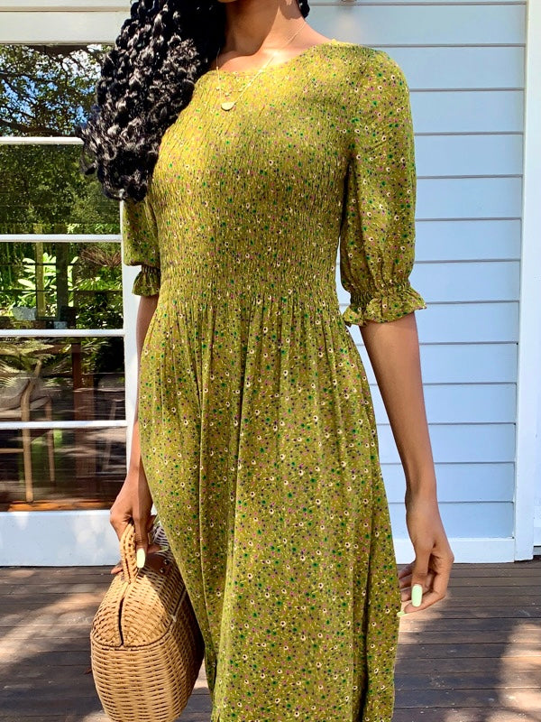 Moss Green vintage inspired dress with vintage florals, features short sleeves and knee length, smock elastic at bust to waist line