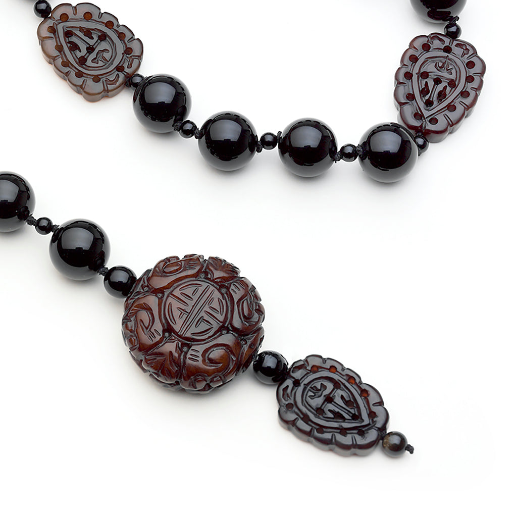 Gloria necklace: Onyx, carved Burma jade pendant and ornaments lariat.