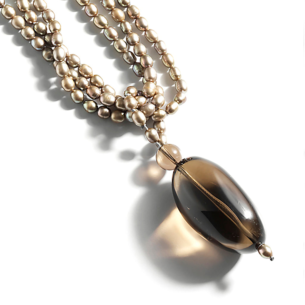 Smoked Pearls necklace: Smoky quartz oval pendant on multi strand rice shaped freshwater pearls.