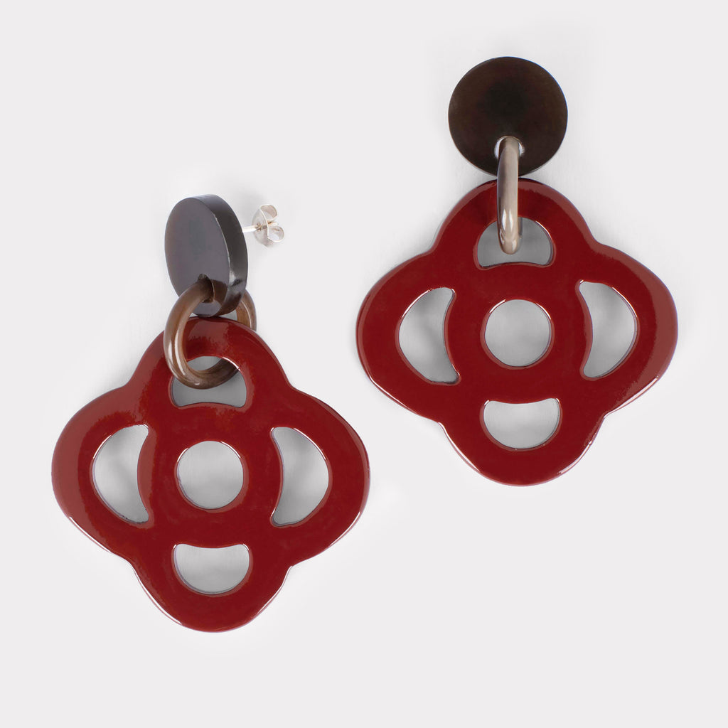 Thea earrings: Carved floral earrings in buffalo horn. Color: crimson.