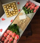caja de rosas salmon y chocolates