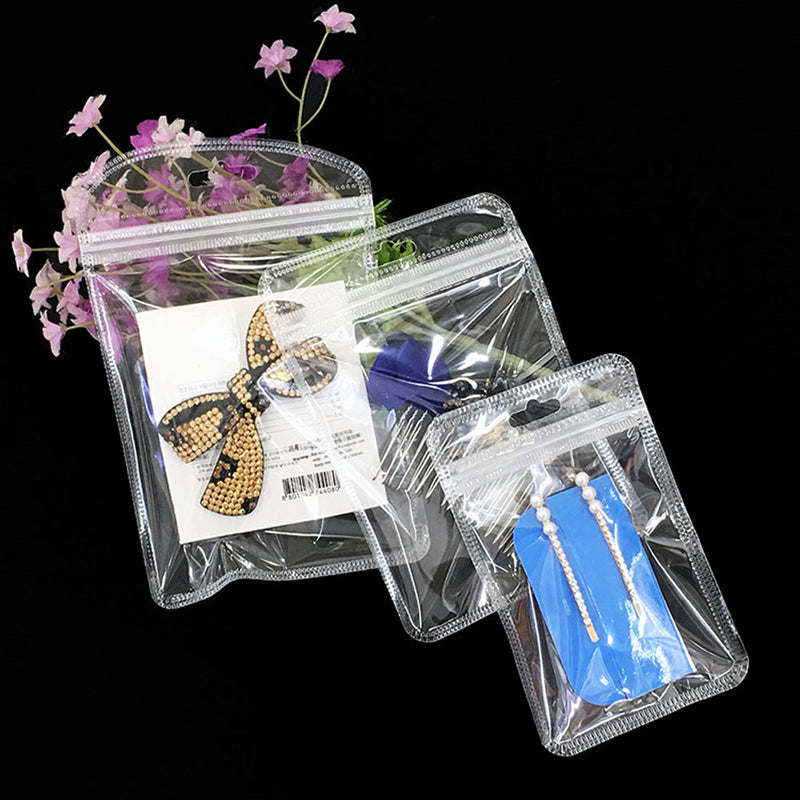 QQ Studio® Lucid Clear Plastic Flat QuickQlick™ Bags with Rounded Corners and Butterfly Hang Hole