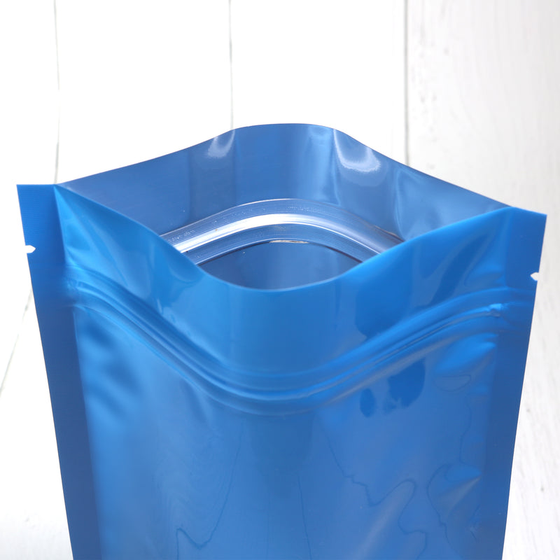 QQ Studio® Glossy Wavy Blue Round Window Plastic and Mylar Stand Strong™ Bags