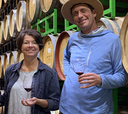 Mindy Oliver and Jeremy Leffert in the Barrel Room of our Winery