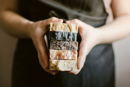 hands holding a stack of handmade bar soap