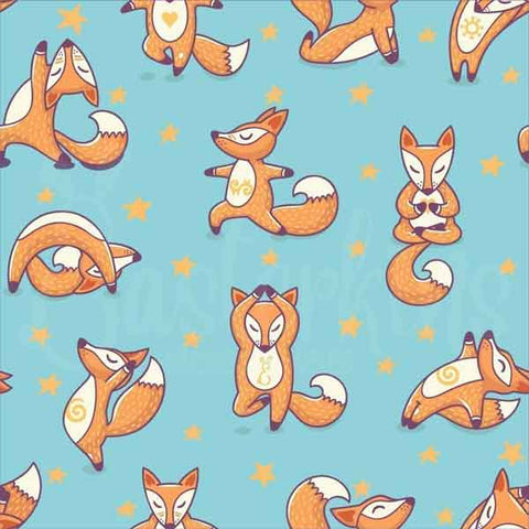 Cute foxes in yoga poses with starts around then on an aqua blue background