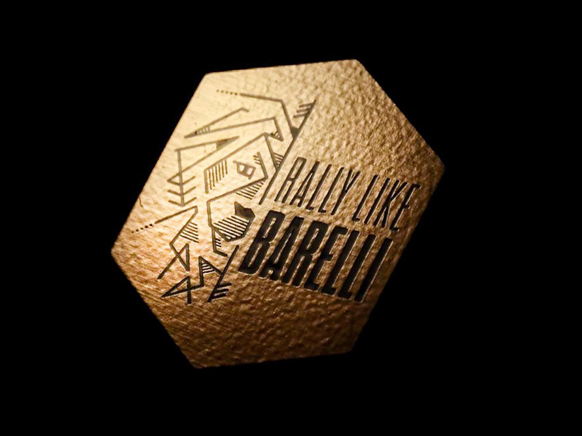 An Image of Yoann Barelli's Signature Lion Decal on a black background. The decal is gold.