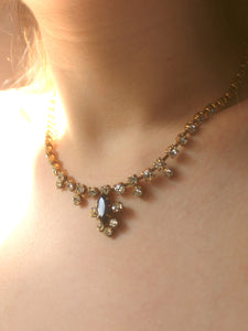 Clear and maroon rhinestone necklace.