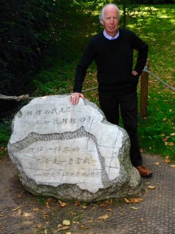 Alan with the ceremonial stone of Xu Zhimo at King's College Cambridge, Cambridge University UK