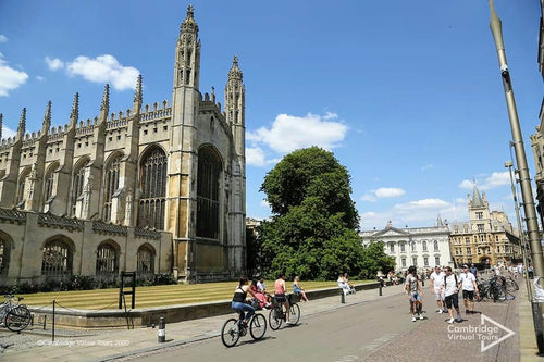 biking outside Kings College Cambridge University UK