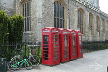 Load image into Gallery viewer, red phone boxes next to Kings College Cambridge University UK