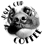 "Ugly Cup Coffee Logo, a dog with a ball surrounded by ""Ugly Cup Coffee"""