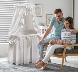 white bedding baby bassinet with canopy