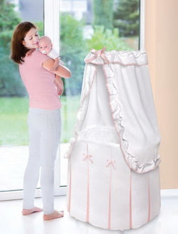 pink and white bedding baby bassinet with canopy