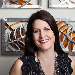 Sondra Gerber creator of Medal Petal Art, Wall Sculptures and Clocks in Aluminum