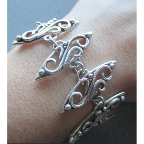 Richelle Leigh Sterling Silver Swirl Bracelet BL31SS Artistic Designer Handcrafted Jewelry