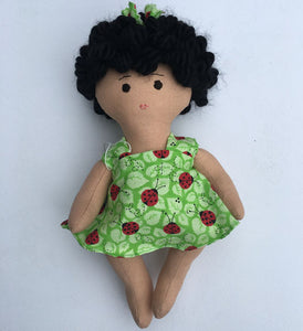 Light brown African-American or biracial baby doll in green dress