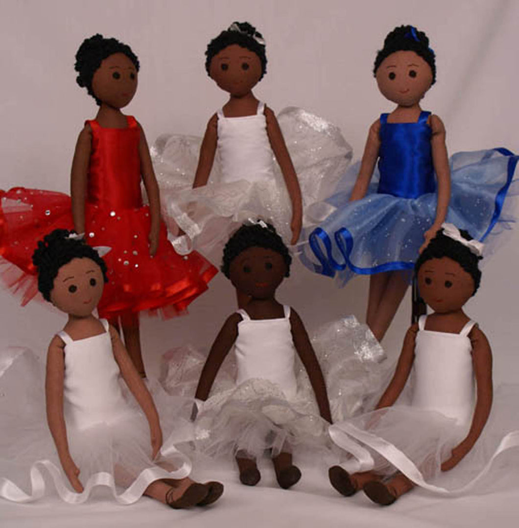 African-American and biracial ballerina dolls in white, red, and blue tutus