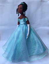 Load image into Gallery viewer, Dark brown Cinderella doll in sky-blue ball gown with beaded crown, side view