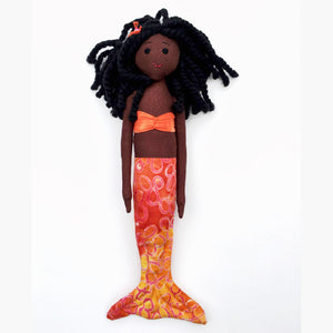 Dark brown African-American mermaid doll with orange tail