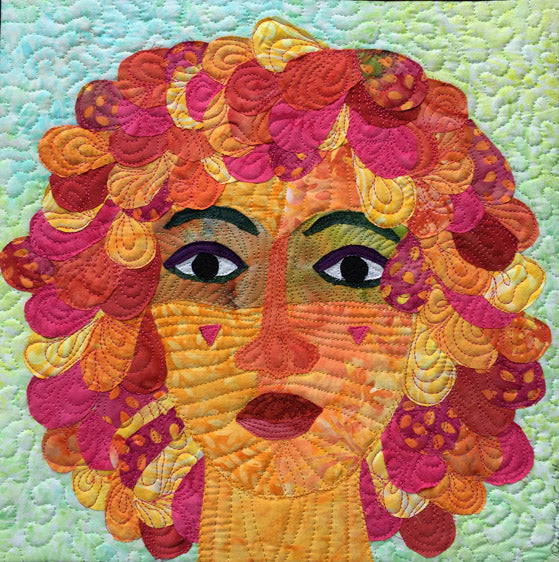 Quilted woman in pink and orange quilt art