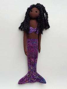 Dark brown African-American mermaid doll with purple tail