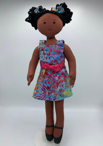 18 inch cloth doll with medium brown skin, afro puffs, and wearing a blue dress